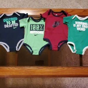 (4) NIKE Bodysuits 0-3 Months - Lot of 4
